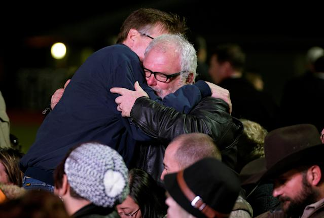 Texas Lt. Gov. Dan Patrick, left, hugs Stephen Willeford, the man who stopped alleged shooter Devin Kelley. at a gathering in Floresville, Texas. (Photo: Rick Wilking/Reuters)
