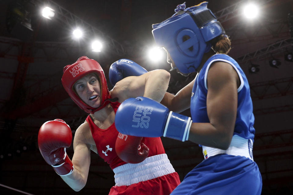 FILE - In this Aug. 2, 2019, file photo, Virginia Fuchs, left, of the United States, battles Ingrit Valencia, of Colombia, and during a women's flyweight boxing final bout at the Pan American Games in Lima, Peru. On the eve of the Tokyo Games, it's clear that just arriving at this point for some of the world's greatest athletes was more of a mental-health challenge than it was a physical one. The COVID-19 postponement altered years of training plans, and the uncertain landscape amid the ongoing pandemic only added to lingering anxiety. (AP Photo/Martin Mejia, File)