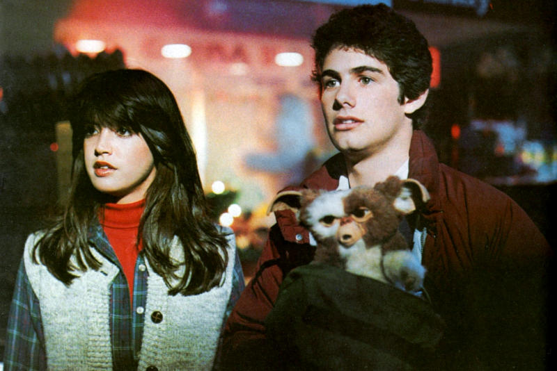 American actors Phoebe Cates and Zach Galligan on the set of Gremlins, directed by Joe Dante. (Photo by Warner Bros. Pictures/Amblin E/Sunset Boulevard/Corbis via Getty Images)