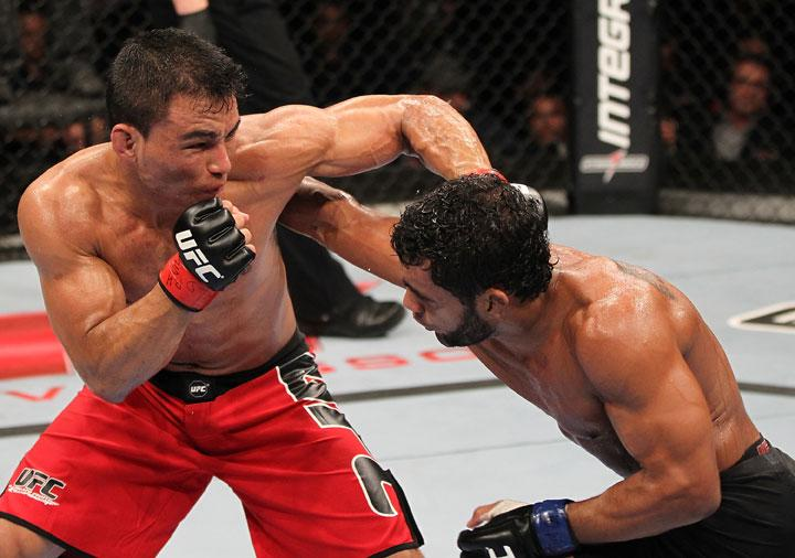 "BELO HORIZONTE, BRAZIL - JUNE 23:   (L-R) John Teixeira and Hugo ""Wolverine"" Viana trade punches during their UFC 147 featherweight bout at Estadio Jornalista Felipe Drummond on June 23, 2012 in Belo Horizonte, Brazil."