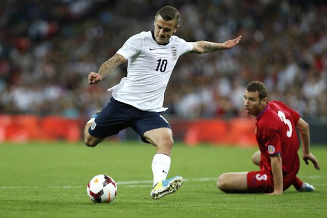 England's Jack Wilshere, left, kicks the ball as Moldova's Victor Golovatenco watches during the World Cup group H qualifier soccer match between England and Moldova at Wembley Stadium in London, Friday, Sept. 6, 2013. (AP Photo/Sang Tan)