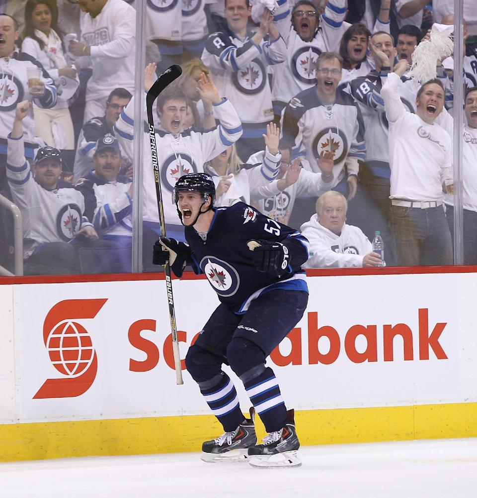 WINNIPEG, MB - APRIL 20: Tyler Myers #57 of the Winnipeg Jets celebrates his goal in second-period action in Game Three of the Western Conference Quarterfinals against the Anaheim Ducks during the 2015 NHL Stanley Cup Playoffs at the MTS Centre on April 20, 2015 in Winnipeg, Manitoba, Canada. (Photo by Marianne Helm/Getty Images)