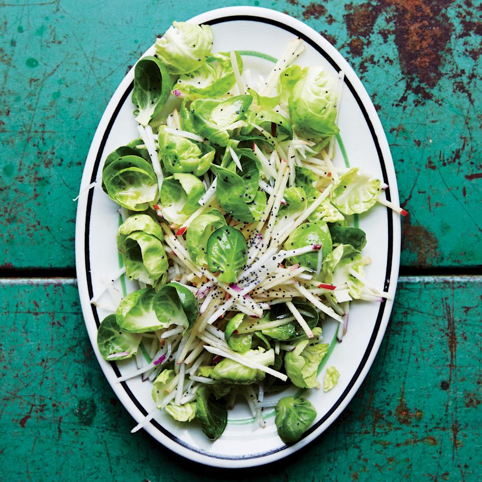 """A crisp, fresh salad that'll brighten up the Thanksgiving table. The poppy seeds add welcome crunch. <a href=""""https://www.epicurious.com/recipes/food/views/crunchy-turnip-apple-and-brussels-sprout-slaw-51260300?mbid=synd_yahoo_rss"""" rel=""""nofollow noopener"""" target=""""_blank"""" data-ylk=""""slk:See recipe."""" class=""""link rapid-noclick-resp"""">See recipe.</a>"""