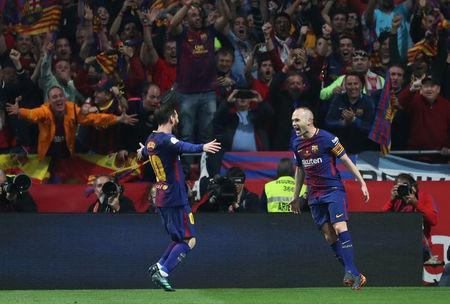 Soccer Football - Spanish King's Cup Final - FC Barcelona v Sevilla - Wanda Metropolitano, Madrid, Spain - April 21, 2018 Barcelona's Andres Iniesta celebrates scoring their fourth goal with Lionel Messi REUTERS/Susana Vera
