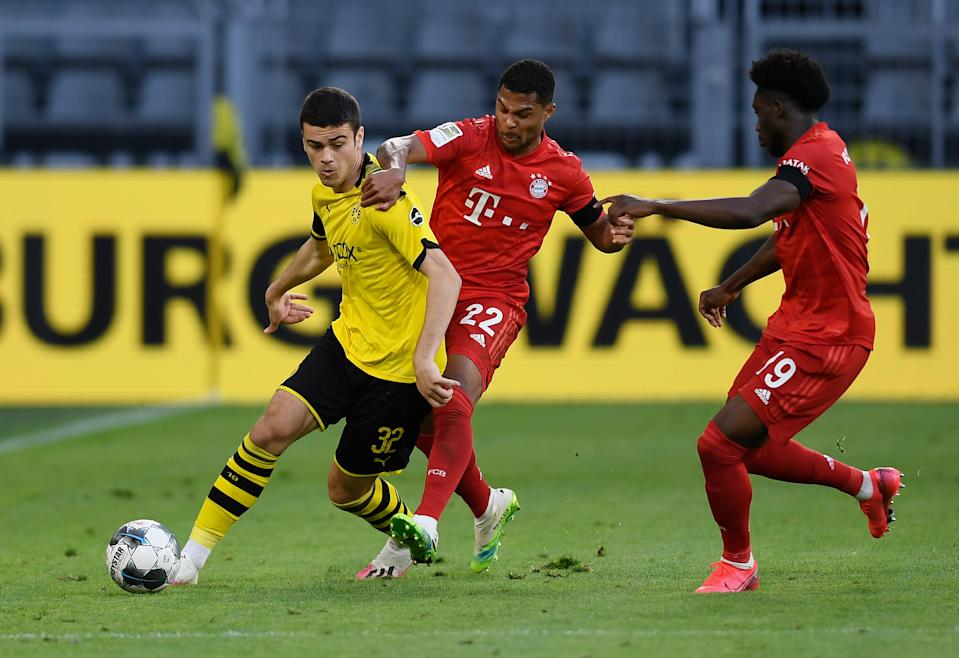 Giovanni Reyna (left) came on in the second half of Borussia Dortmund's 1-0 loss to Bayern Munich on Tuesday. (Alexandre Simoes/Getty Images)