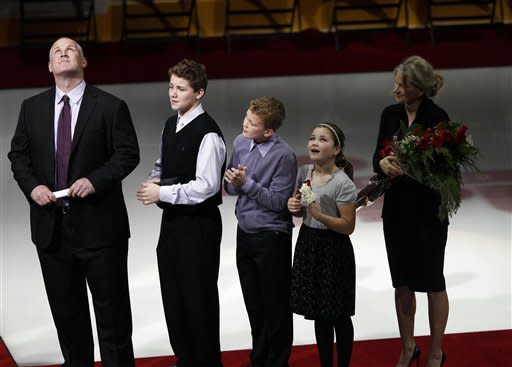 From left, former Phoenix Coyotes' Keith Tkachuk, his sons Matthew and Brady, daughter Taryn and his wife Chantel watch the unveiling of Tkachuk's number in the Coyotes Ring of Honor prior to an NHL hockey game against the St. Louis Blues, Friday, Dec. 23, 2011, in Glendale, Ariz. (AP Photo/Matt York)