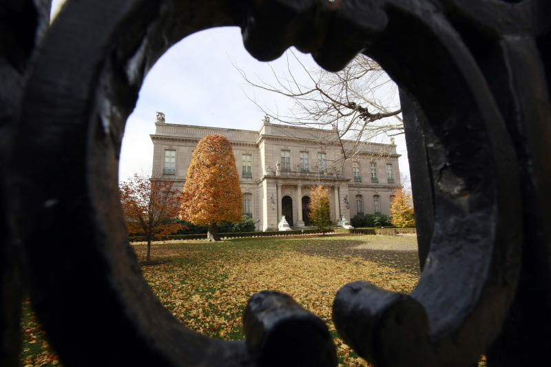 """FILE - This Nov. 19, 2010 file photo shows the Elms mansion as seen through an opening in an iron fence, in Newport, R.I.  Newly discovered photographs, documents and family histories have inspired the creation of a tour about servants at The Elms, echoing themes of the British drama program, """"Downton Abbey."""" (AP Photo/Steven Senne, File)"""