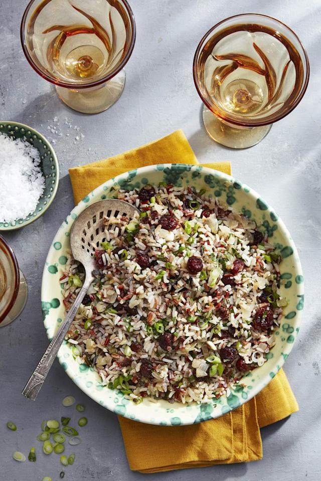 """<p>Spice up this cranberry pilaf with a stick of cinnamon. </p><p><strong><a rel=""""nofollow"""" href=""""https://www.countryliving.com/food-drinks/a23390979/wild-rice-and-cider-cranberry-pilaf-recipe/"""">Get the recipe.</a></strong></p>"""