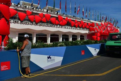 A worker waters the plants in front of the red carpet of the 69th Venice film festival, August 2012. With much of the traditional cinema sector in a state of flux, Venice film festival participants said the industry is looking to a future in which the Internet will play an ever bigger role
