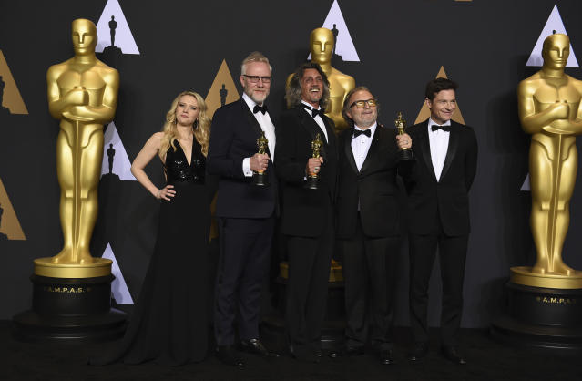 """Christopher Nelson, second from left, Giorgio Giorgio, center, and Alessandro Bertolazzi, second from right, winners of the award for best makeup and hairstyling for """"Suicide Squad"""" pose in the press room with Kate McKinnon, left, and Jason Bateman, right, in the press room at the Oscars on Sunday, Feb. 26, 2017, at the Dolby Theatre in Los Angeles. (Photo by Jordan Strauss/Invision/AP)"""