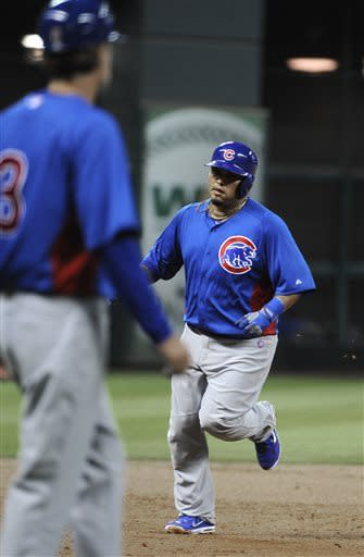 Chicago Cubs' Dioner Navarro, right, rounds the bases on a solo home run against the Houston Astros in the second inning of an exhibition baseball game on Friday, March 29, 2013, in Houston. (AP Photo/Pat Sullivan)