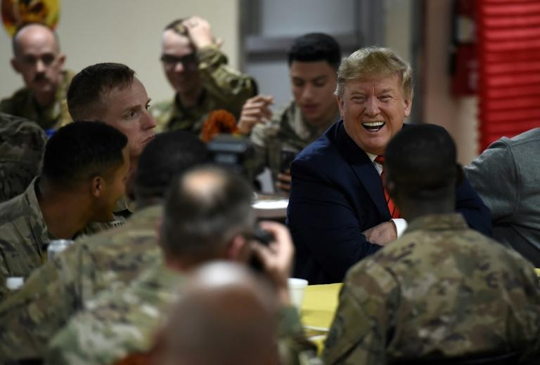 US President Donald Trump eats Thanksgiving dinner with US troops in Afghanistan (AFP Photo/Olivier Douliery)