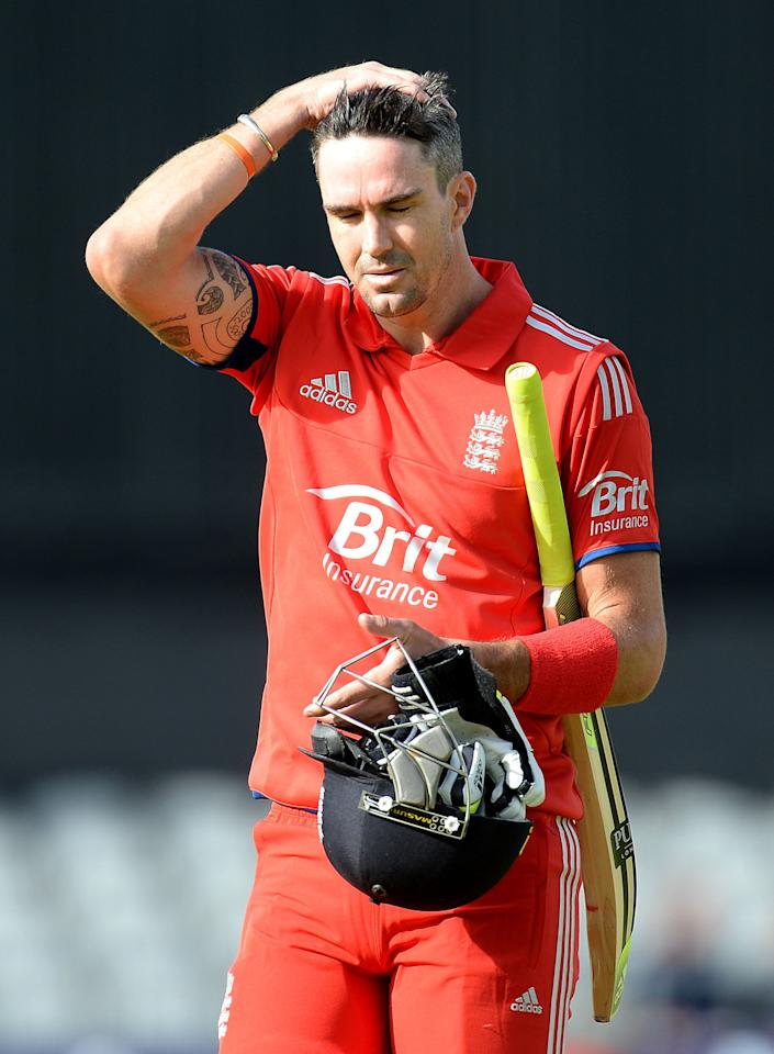 England's Kevin Pietersen leaves the field after being caught out by James Faulkner from Shane Watson's bowling, during the Second One Day International at Old Trafford Cricket Ground, Manchester.