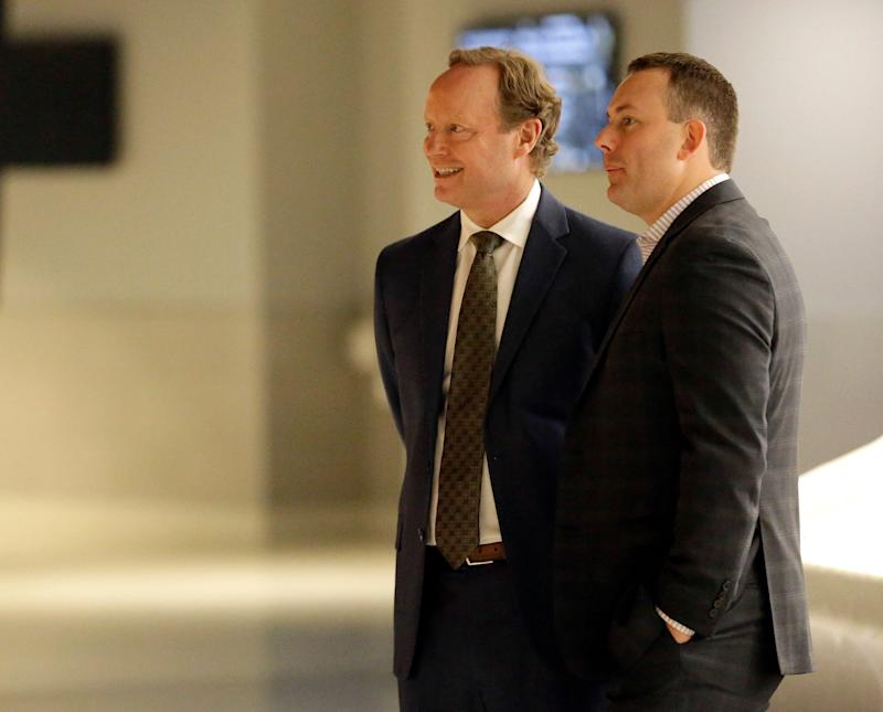Milwaukee Bucks new head coach Mike Budenholzer speaks with general manager Jon Horst at a news conference in the team's new arena Monday, May 21, 2018, in Milwaukee. (AP Photo/Aaron Gash)