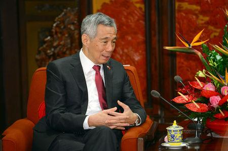 Singapore's Prime Minister Lee Hsien Loong speaks with Chinese Vice President Wang Qishan in Beijing