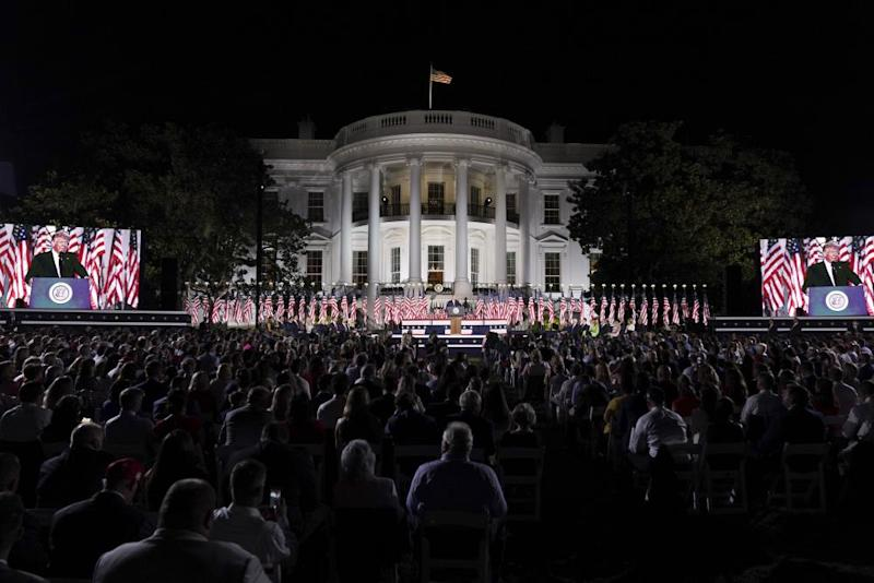 U.S. President Donald Trump, center, speaks during the Republican National Convention on the South Lawn of the White House in Washington, D.C., U.S., on Thursday, Aug. 27, 2020. Trump is asking Americans to return him to office in the speech closing the convention, arguing that voters can't trust Joe Biden or the Democratic Party to navigate the coronavirus pandemic or salve the nation's racial divisions.