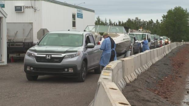 A lineup of cars is shown as people arrive on P.E.I. via the ferry. Some rapid testing for COVID-19 will now take place onboard some Northumberland Ferries crossings to the Island. (Laura Meader/CBC - image credit)