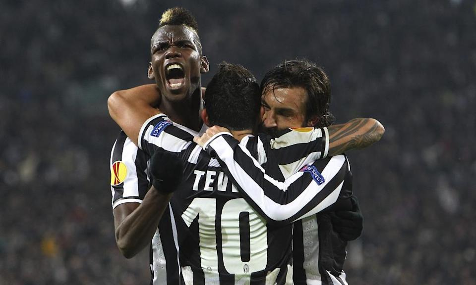 Paul Pogba (left), Carlos Tevez and Andrea Pirlo, here celebrating a goal against Trabzonspor in 2014, are among Fabio Paratici's notable signings for Juventus.