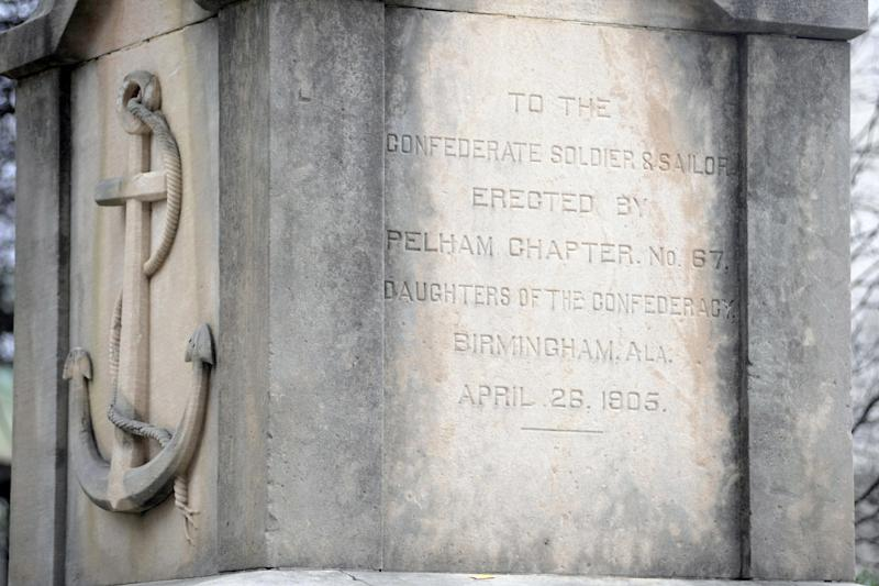 FILE - This Feb. 9, 2016, file photo, shows inscriptions on a Confederate monument in Linn Park in downtown Birmingham, Ala. The Alabama Legislature has approved a bill Friday, May 19, 2017, that would prohibit the removal of historic monuments that have stood for more than 40 years. (AP Photo/Jay Reeves, File)