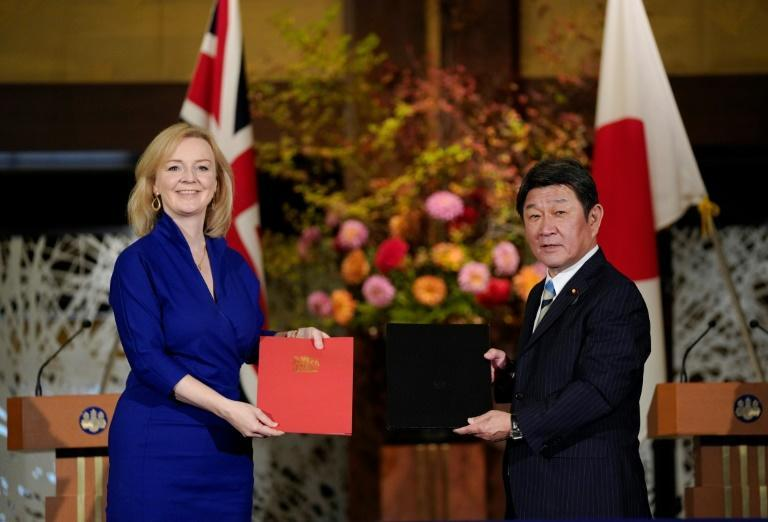 Britain's Liz Truss hailed the country's first major post-Brexit trade deal after a signing ceremony with Japanese Foreign Minister Toshimitsu Motegi