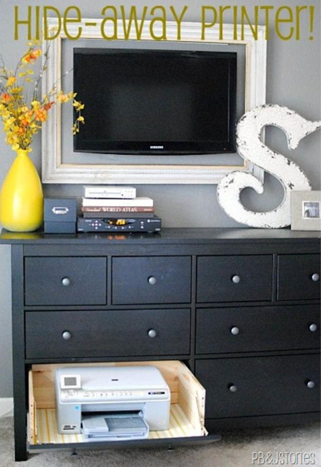 "<p>When you put the front of a dresser drawer on a hinge, you can keep your printer in your bedroom without feeling like you're still at the office.</p><p><em><a rel=""nofollow"" href=""http://www.pbjstories.com/2012/01/my-hide-away-printer-project.html"">See more at PB&J Stories »</a></em><a rel=""nofollow"" href=""http://www.pbjstories.com/2012/01/my-hide-away-printer-project.html""></a></p>"