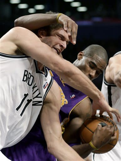 Brooklyn Nets' Brook Lopez, left, and Los Angeles Lakers' Antawn Jamison fight for a rebound during the first half of the NBA basketball game at the Barclays Center Tuesday, Feb. 5, 2013 in New York. (AP Photo/Seth Wenig)