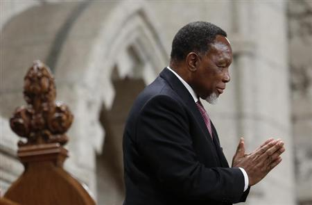 South Africa's Deputy President Motlanthe gestures while being recognized by the Speaker in the House of Commons on Parliament Hill in Ottawa