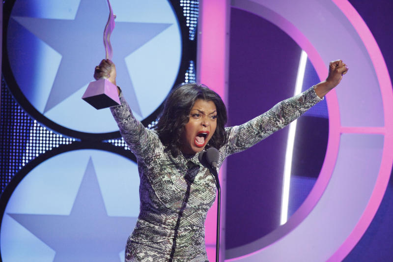 In this Oct. 15, 2011 photo released by BET, actress and singer Taraji P. Henson reacts as she is honored at the 6th annual Black Girls Rock! Awards in New York.  The awards show will be broadcast on BET, Sunday, Nov. 6, at 8 p.m. EST. (AP Photo/BET, Scott Weiner)