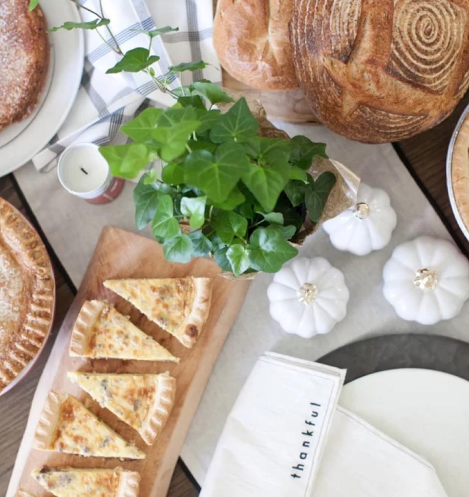 white pumpkins on table with quiche and bread, fall decorating tips