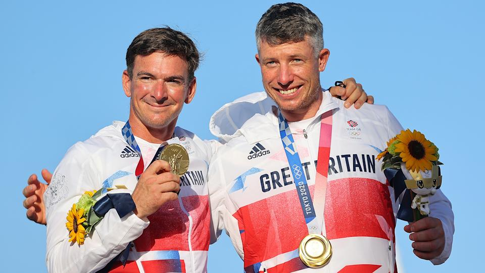 Tokyo 2020 Olympics - Sailing - Men's 49er - Medal Ceremony - Enoshima Yacht Harbour - Tokyo, Japan - August 3, 2021. Gold medallists Dylan Fletcher of Britain and Stuart Bithell of Britain celebrate on the podium. REUTERS/Carlos Barria