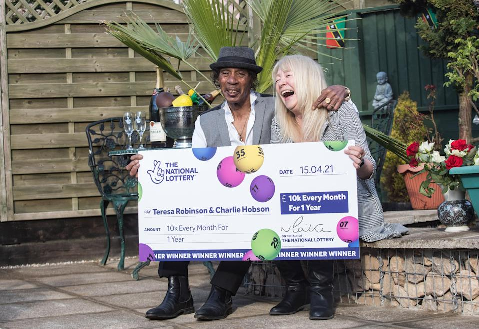 Nurse Teresa Robinson, 65, plans to buy a home on the island of Nevis in the Caribbean with her partner Charlie Hobson, 62, after winning £10,000 per month for a year on the National Lottery's Set For Life draw. (National Lottery/ PA)