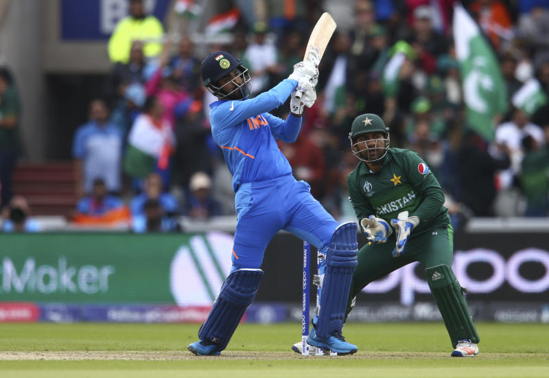 India's K.L. Rahul plays a shot to reaches a half century during the Cricket World Cup match between India and Pakistan at Old Trafford in Manchester, England, Sunday, June 16, 2019. (AP Photo/Dave Thompson)
