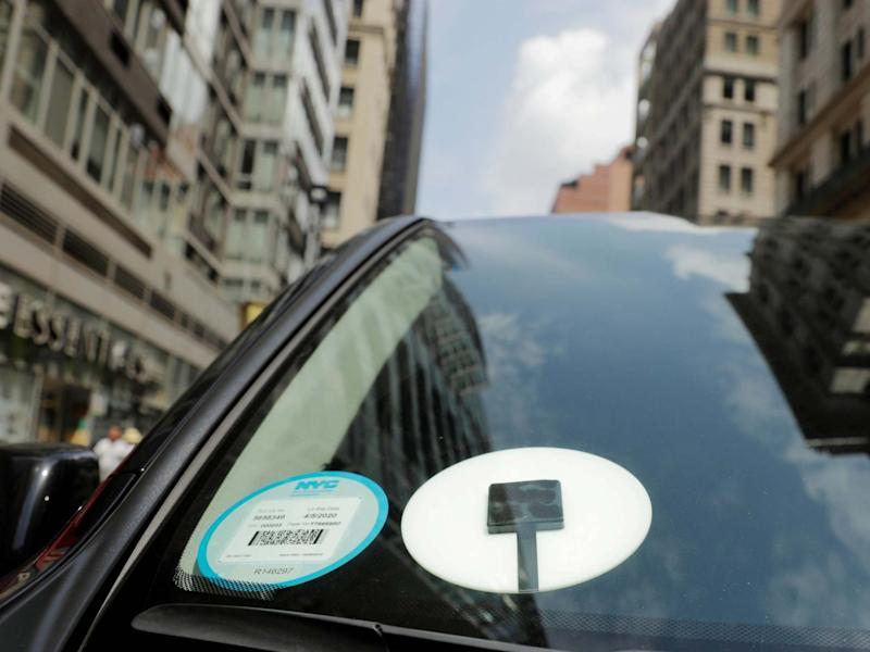 A car with an Uber logo on it drives down the street in New York, US: REUTERS