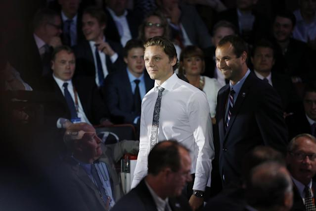 Sam Reinhart walks to the stage after being chosen second overall by the Buffalo Sabres during the first round of the NHL hockey draft, Friday, June 27, 2014, in Philadelphia. (AP Photo/Matt Slocum)