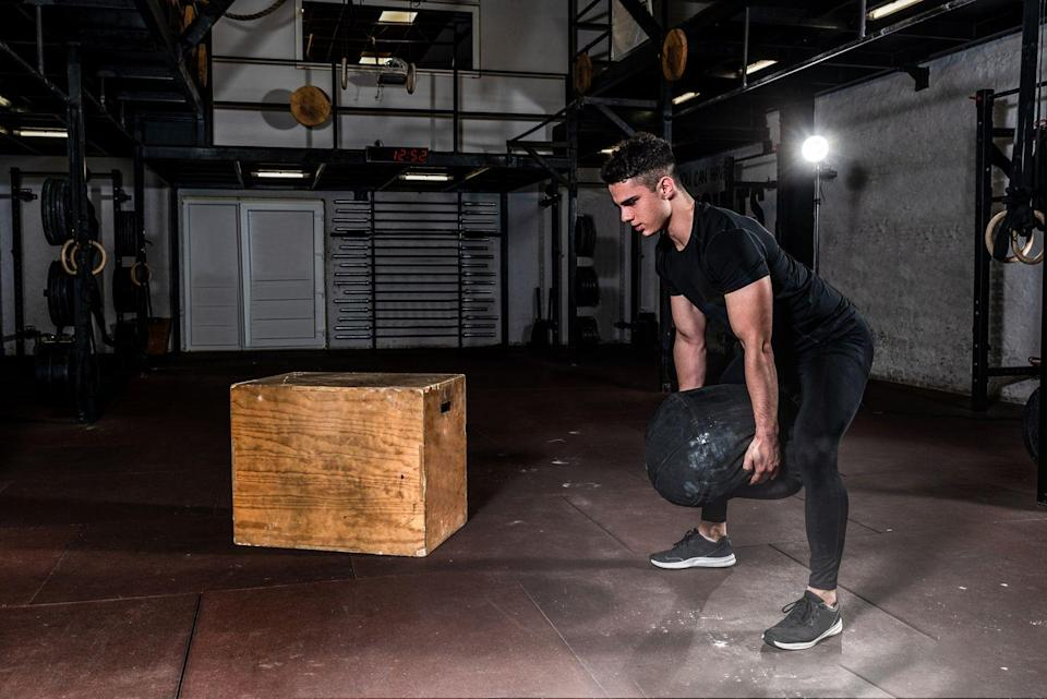 <p><strong>You'll need: Sandbag, or heavy awkward object (backpack, soil bag, duffel bag)</strong></p><p><strong>Sandbag to Shoulder x 50</strong></p><p>With the sandbag on the floor between your feet, hinge down to grip it in both hands, keeping your back straight. Hug the bag, lift it to your chest, then sit down resting it on your thighs. Now Stand up explosively and simultaneously thrust the bag up onto your shoulder. Drop to the floor and repeat, alternating shoulders each rep.</p><p><strong>Sandbag Push Press x 50</strong></p><p>With the sandbag on the floor between your feet, hinge down to grip it in both hands, keeping your back straight Hug the bag, lift it to your chest and rest it on your thighs. Now Stand up explosively and simultaneously thrust the bag onto your chest, just in front of your face. Holding the sandbag across your chest, brace your core and dip your legs slightly before exploding upwards. Press the bag overhead until your arms are locked out. Pause briefly at the top before lowering the bag back to your chest under control. Repeat.</p><p><strong>Push-ups x 100</strong></p><p>Assume a strong plank position; your wrists, elbows and shoulders should be directly above one another: think about creating a rigid frame from ankles to head. Flex at the elbow, lowering your body, and pause as your chest touches the floor. Push up explosively and repeat.</p><p><strong>EMOM) Bear Hug Carry x 15m</strong></p><p>With the bag firmly gripped to your chest take short, powerful strides. Keep your head up and back straight<strong>.</strong> If you drop the bag, pick it up from where you left off and continue until you hit 15m. As soon as you hit your distance, get back to work on those reps.</p>