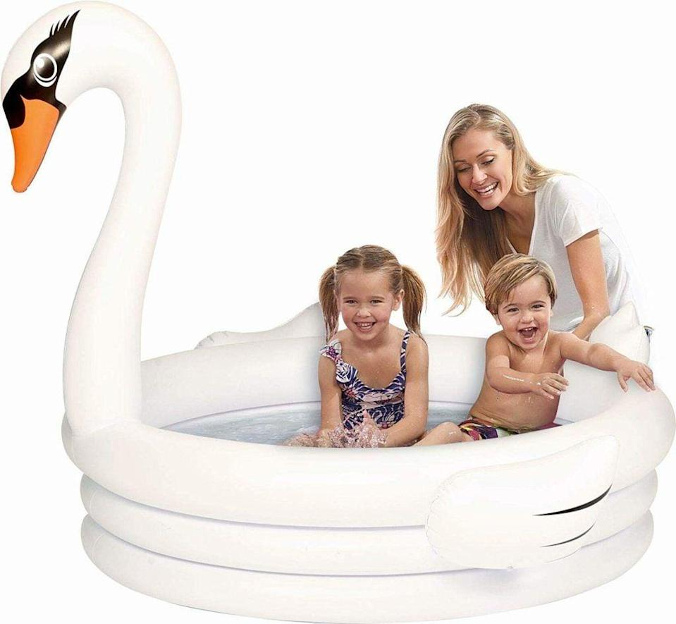 """<p>Your kids will have the best time playing in this <a href=""""https://www.popsugar.com/buy/White-Swan-Inflatable-Kiddie-Pool-572401?p_name=White%20Swan%20Inflatable%20Kiddie%20Pool&retailer=watsons.com&pid=572401&price=35&evar1=moms%3Aus&evar9=46219004&evar98=https%3A%2F%2Fwww.popsugar.com%2Fphoto-gallery%2F46219004%2Fimage%2F47457514%2FWhite-Swan-Inflatable-Kiddie-Pool&list1=shopping%2Cpools%2Csummer%2Ckid%20shopping&prop13=api&pdata=1"""" class=""""link rapid-noclick-resp"""" rel=""""nofollow noopener"""" target=""""_blank"""" data-ylk=""""slk:White Swan Inflatable Kiddie Pool"""">White Swan Inflatable Kiddie Pool</a> ($35).</p>"""