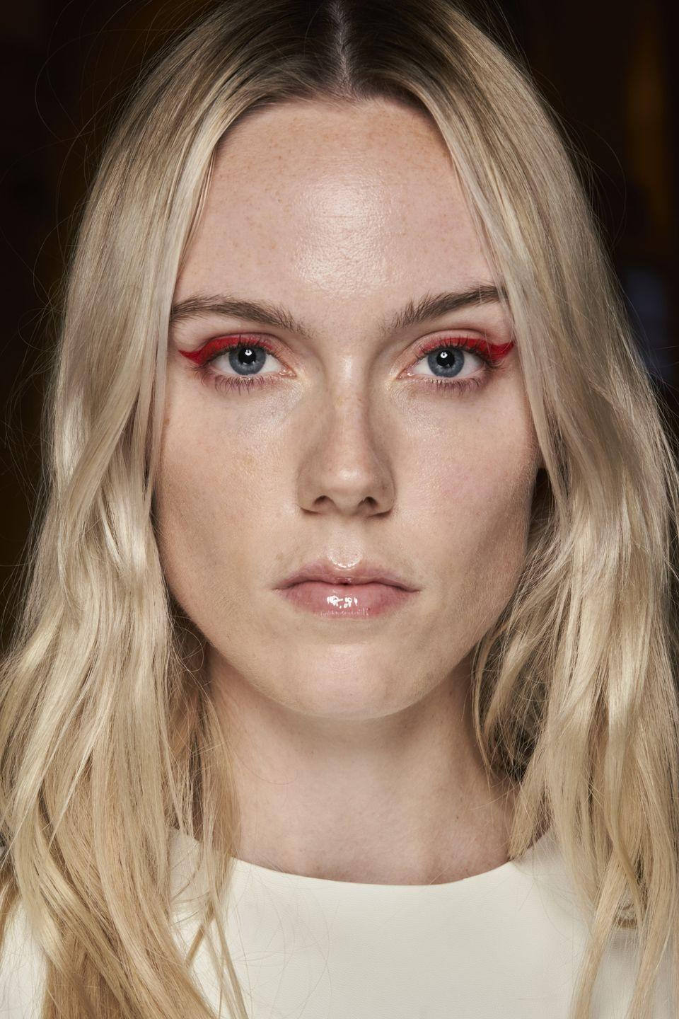 <p>Switch up your go-to feline cat eye with some scarlet red liquid liner in place of the classic black.</p>