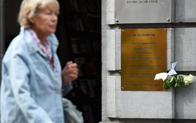 A woman leaves on September 14, 2014, after attending a ceremony marking the reopening of the Brussels Jewish Museum, which had closed following a deadly shooting in May 2014