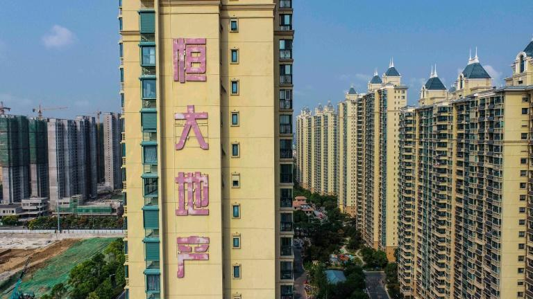 As Evergrande's default appears all but inevitable, fears are abounding of a contagion within the Chinese property market -- and far beyond (AFP/STR)