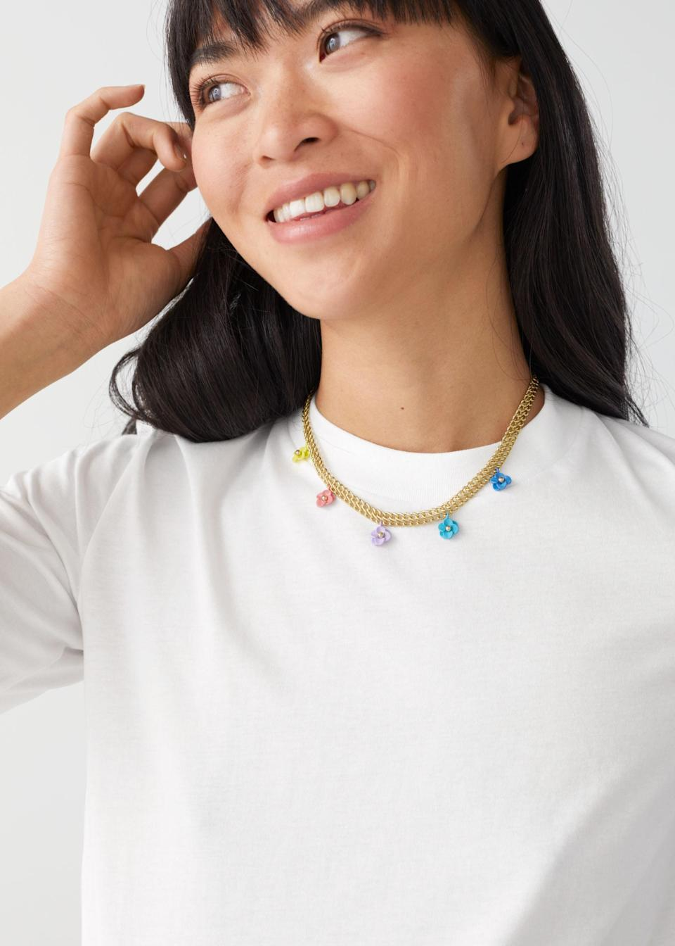 """When the weather's dreary, instantly brighten your neckline (and mood) with this multicolored daisy chain necklace. $49, & Other Stories. <a href=""""https://www.stories.com/en_usd/jewellery/necklaces/product.mini-flower-pendant-chain-necklace-gold.0916806001.html"""" rel=""""nofollow noopener"""" target=""""_blank"""" data-ylk=""""slk:Get it now!"""" class=""""link rapid-noclick-resp"""">Get it now!</a>"""