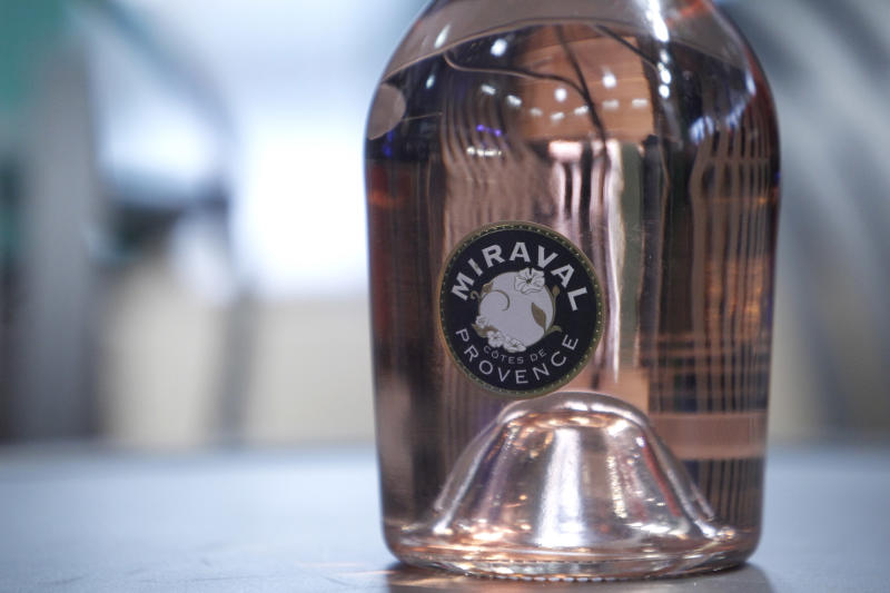 """CAPTION CORRECTS NAME OF BOTTLE FROM MIRAMAR TO MIRAVAL A botlle of Miraval 2013 is pictured in Paris, Friday, Jan.31, 2014. The latest Brad Pitt-Angelina Jolie sequel is being described as powerful and elegant with a """"mouthwatering finish."""" These raves don't appear in Hollywood bible Variety _ they're from Decanter magazine's review of the celebrity couple's second vintage of rose wine produced at their Provencal estate Chateau Miraval. The 2013 Miraval goes on sale online Friday and will be in shops and restaurants around the world next month. (AP Photo/Thibault Camus)"""