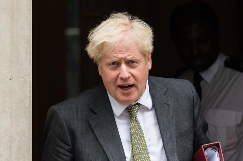 LONDON, UNITED KINGDOM - SEPTEMBER 23, 2020: British Prime Minister Boris Johnson leaves 10 Downing Street for PMQs at the House of Commons on 23 September, 2020 in London, England. Yesterday, Boris Johnson announced a set of new restrictions to try to stop the spread of coronavirus in England including a 10 p.m. curfew for pubs and restaurants, working from home where possible, compulsory face masks for bar staff, non-seated customers, shop workers and waiters, and fines for not wearing masks or following rules increased to £200 for first offence.- PHOTOGRAPH BY Wiktor Szymanowicz / Barcroft Studios / Future Publishing (Photo credit should read Wiktor Szymanowicz/Barcroft Media via Getty Images)