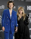 """FILE - Harry Styles, left, and inductee Stevie Nicks pose in the press room at the Rock & Roll Hall of Fame induction ceremony in New York on March 29, 2019. Nicks has become close friends when the former One Direction member since he invited her to perform at one of his concerts in 2017. Since then, they're performed several times together and Styles even previewed his latest album, """"Fine Line,"""" for her and some of her friends before it was released in December. (Photo by Charles Sykes/Invision/AP, File)"""