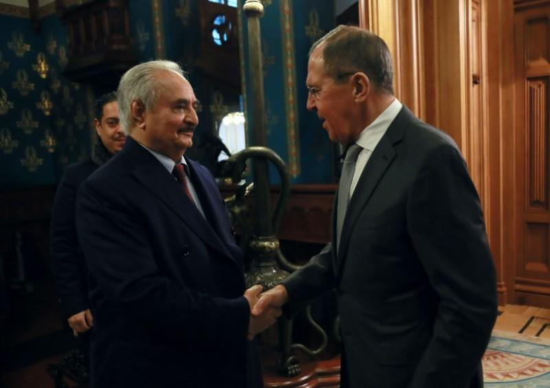 Commander of the Libyan National Army Khalifa Haftar shakes hands with Russian Foreign Minister Sergei Lavrov before talks in Moscow