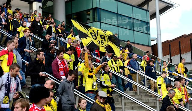 Borussia Dortmund fans make their way from Wembley Park Station near Wembley Stadium before the game.