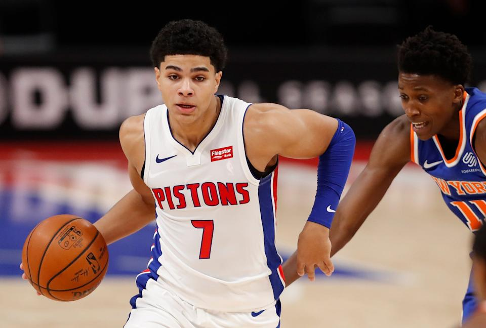 Detroit Pistons guard Killian Hayes is defended by New York Knicks guard Frank Ntilikina on Dec. 11, 2020, during a preseason game at Little Caesars Arena.