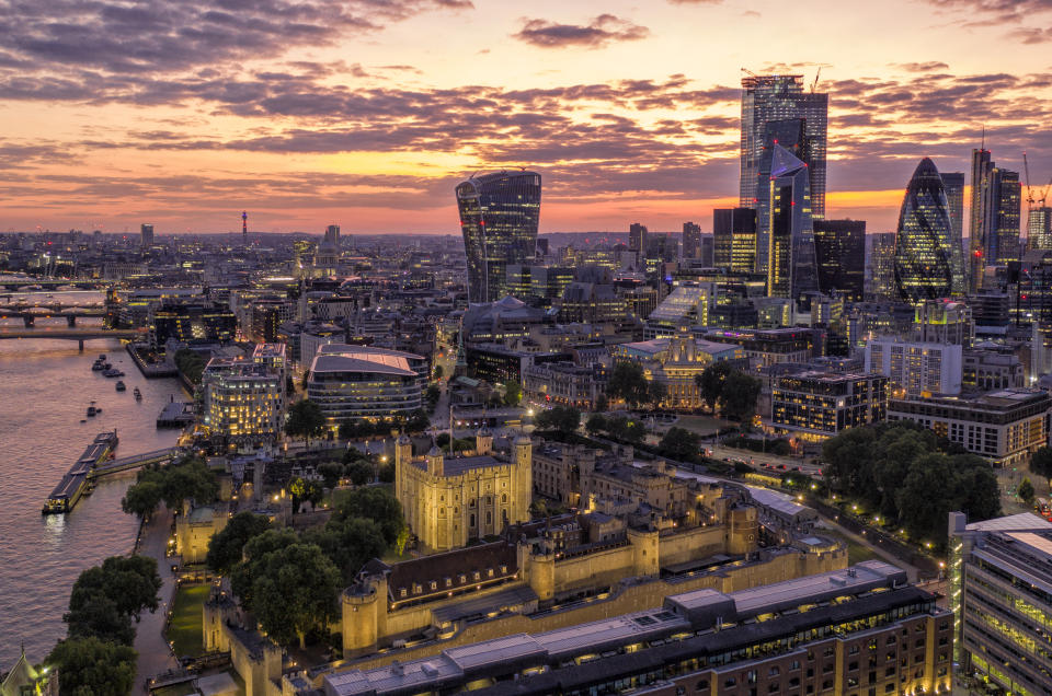 LONDON, UNITED KINGDOM - JULY 13: (EDITORS NOTE: This image was processed using digital filters) The Tower of London is lit up as the sun sets behind the city of London on Saturday night on July 13, 2019 in London, United Kingdom.The Tower of London was built by William the Conqueror in 1078. (Photo by Chris Gorman/Getty Images)