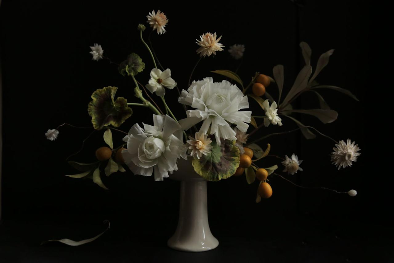 """<p>Opt to include lots of textural elements—like citrus and dried flowers—to capture the essence of the season, without opting for something literal, like all-white.</p><p><em>Flowers by <a href=""""http://arieldearieflowers.com/"""" target=""""_blank"""">Ariel Dearie Flowers</a></em></p>"""