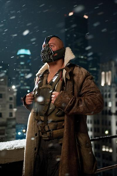 """This undated film image released by Warner Bros. Pictures shows Tom Hardy as Bane in a scene from the action thriller """"The Dark Knight Rises."""" A gunman in a gas mask barged into a crowded Denver-area theater during a midnight premiere of the Batman movie on Friday, July 20, 2012, hurled a gas canister and then opened fire, killing 12 people and injuring at least 50 others in one of the deadliest mass shootings in recent U.S. history. (AP Photo/Warner Bros. Pictures, Ron Phillips)"""