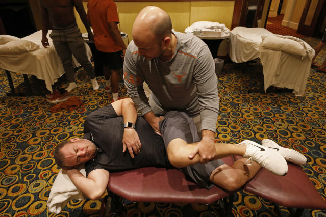 Texas Longhorns head coach Tom Herman is adjusted by team chiropractor Jordan Pellien Friday Sept. 6, 2019 at the team hotel in Austin, Tx. ( Photo by Edward A. Ornelas )